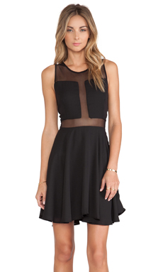 Donna Mizani Paneled Flounce Dress in Black