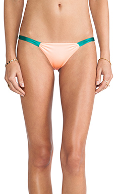 Indah Reversible Slash String Bottom in Peach & Teal