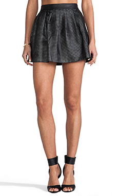 This is a Love Song Perforated Leather Warrior Skirt in Black/White